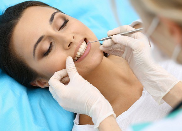 woman laying getting gum disease prevention
